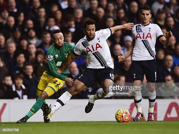 Mousa Dembele of Tottenham Hotspur is challenged by Nathan Redmond of Norwich City during the Barclays Premier League match between Tottenham Hotspur...