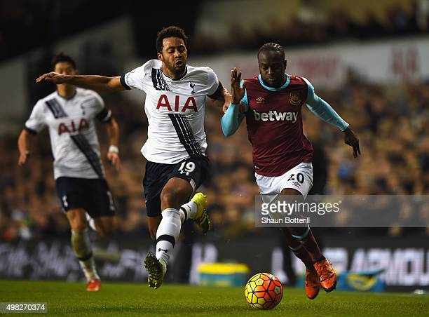 Mousa Dembele of Tottenham Hotspur is challenged by Victor Moses of West Ham United during the Barclays Premier League match between Tottenham...