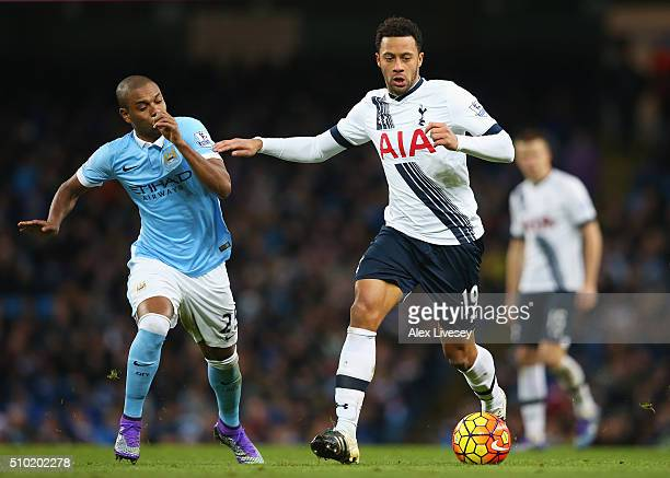 Mousa Dembele of Tottenham Hotspur is closed down by Fernandinho of Manchester City during the Barclays Premier League match between Manchester City...