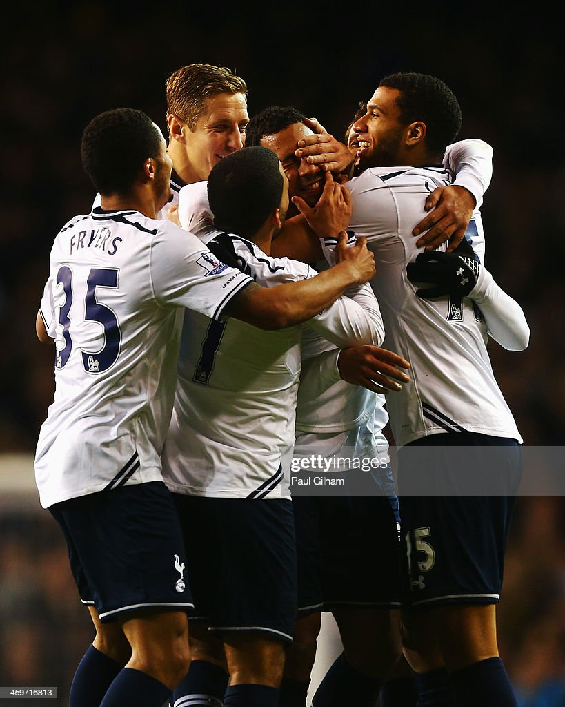 Mousa Dembele of Tottenham Hotspur is mobbed by team mates after scoring his team's second goal during the Barclays Premier League match between Tottenham Hotspur and Stoke City at White Hart Lane on December 29, 2013 in London, England.
