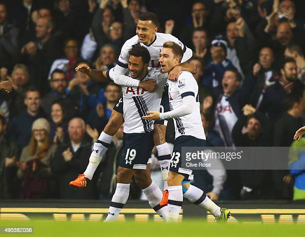 Mousa Dembele of Tottenham Hotspur is mobbed by team mates Dele Alli and Christian Eriksen as he celebrates scoring their frst goal during the...