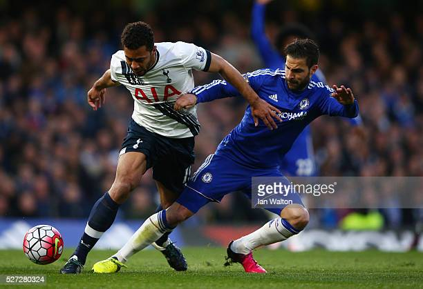Mousa Dembele of Tottenham Hotspur is tackled by Cesc Fabregas of Chelsea during the Barclays Premier League match between Chelsea and Tottenham...