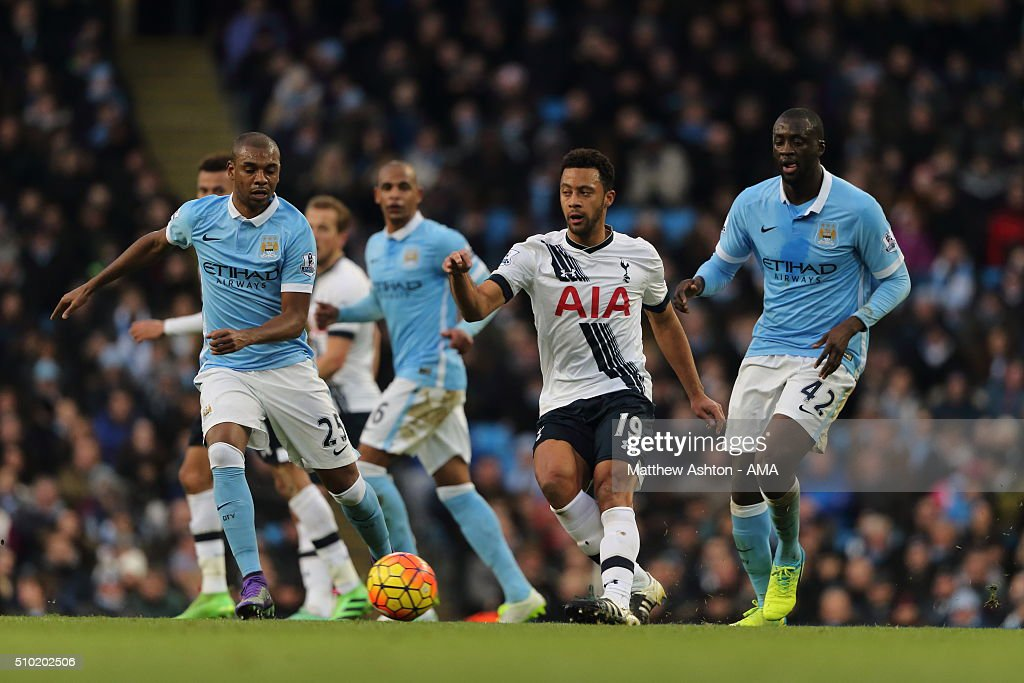 Mousa Dembele of Tottenham Hotspur passes through Fernandinho and Yaya Toure of Manchester City during the Barclays Premier League match between Manchester City and Tottenham Hotsput at the Etihad Stadium Bloomfield Road on February 14, 2016 in Manchester, England.