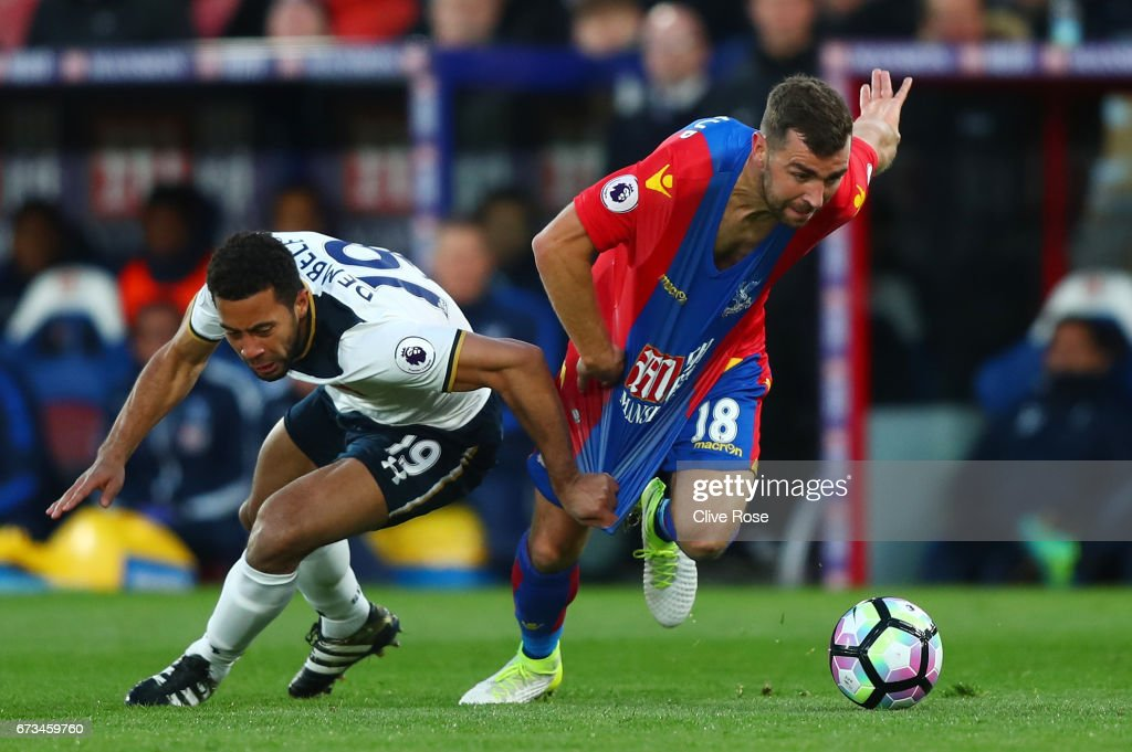 Mousa Dembele of Tottenham Hotspur pulls back James McArthur of Crystal Palace during the Premier League match between Crystal Palace and Tottenham Hotspur at Selhurst Park on April 26, 2017 in London, England.