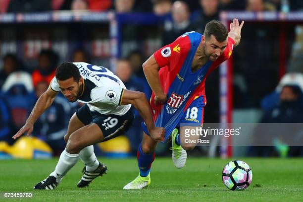 Mousa Dembele of Tottenham Hotspur pulls back James McArthur of Crystal Palace during the Premier League match between Crystal Palace and Tottenham...