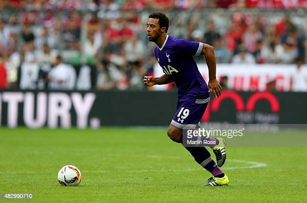 Mousa Dembele of Tottenham Hotspur runs with the ball during the Audi Cup 2015 match between Real Madrid and Tottenham Hotspur at Allianz Arena on...