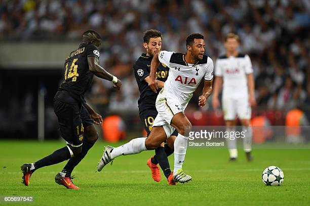 Mousa Dembele of Tottenham Hotspur skips past Tiemoue Bakayoko of AS Monaco during the UEFA Champions League match between Tottenham Hotspur FC and...