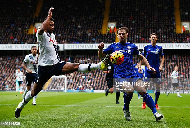Mousa Dembele of Tottenham Hotspur stretches for the ball ahead of Branislav Ivanovic of Chelsea during the Barclays Premier League match between...