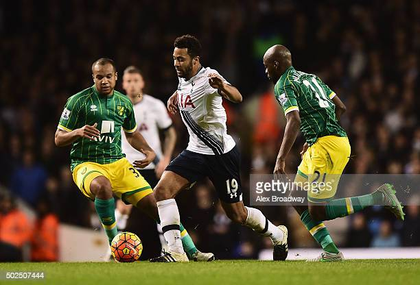 Mousa Dembele of Tottenham Hotspur takes on Vadis Odjidja Ofoe and Youssouf Mulumbu of Norwich City during the Barclays Premier League match between...
