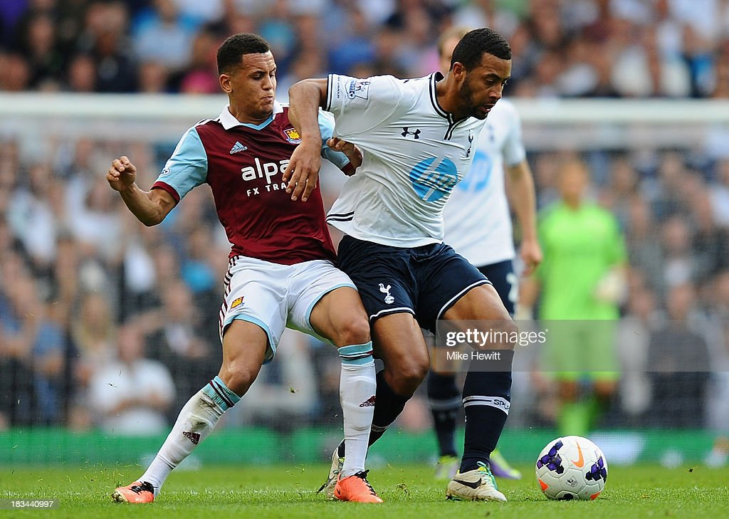 Mousa Dembele of Tottenham (R) is challenged by <a gi-track='captionPersonalityLinkClicked' href=/galleries/search?phrase=Ravel+Morrison&family=editorial&specificpeople=5621330 ng-click='$event.stopPropagation()'>Ravel Morrison</a> of West Ham during the Barclays Premier League match between Tottenham Hotspur and West Ham United at White Hart Lane on October 6, 2013 in London, England.
