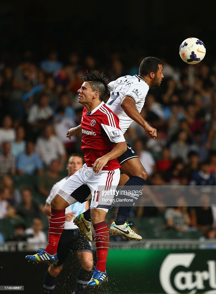 Mousa Dembele of Tottenhan Hotspur heads the ball during the Third Place Play-Off match between Tottenham Hotspur and South China at Hong Kong Stadium on July 27, 2013 in So Kon Po, Hong Kong.