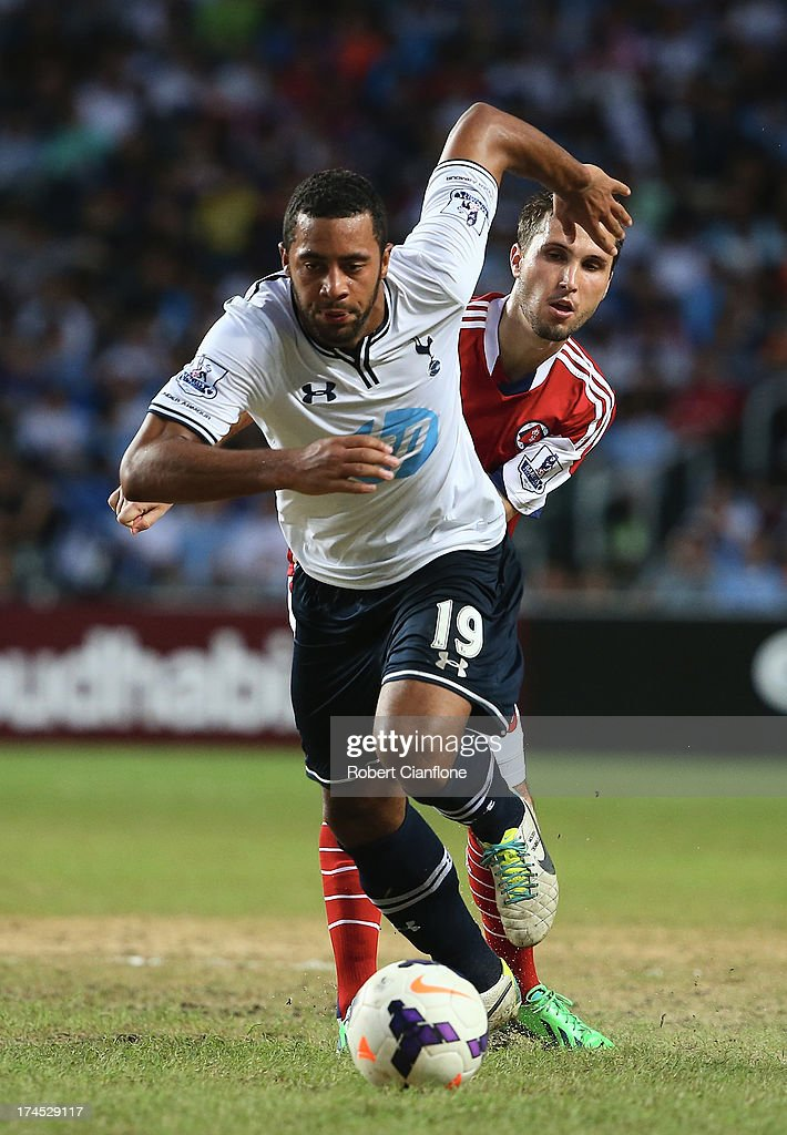 Mousa Dembele of Tottenhan Hotspur runs with the ball during the Third Place Play-Off match between Tottenham Hotspur and South China at Hong Kong Stadium on July 27, 2013 in So Kon Po, Hong Kong.