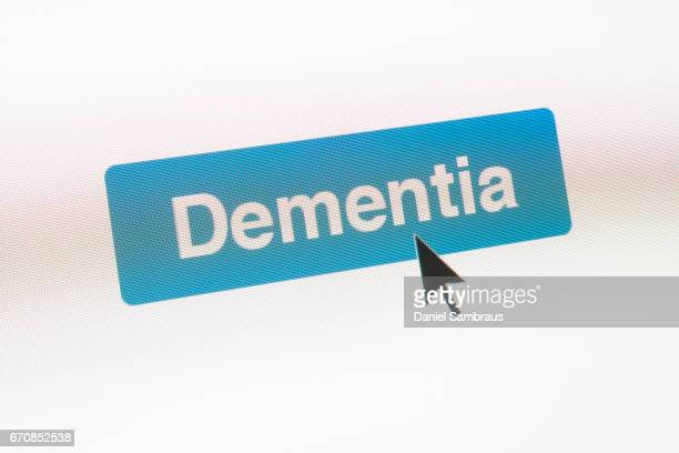 Mouse arrow clicking on DEMENTIA button on computer screen