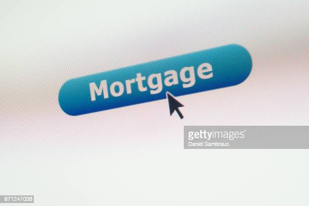 Mouse arrow clicking on MORTGAGE button on computer screen