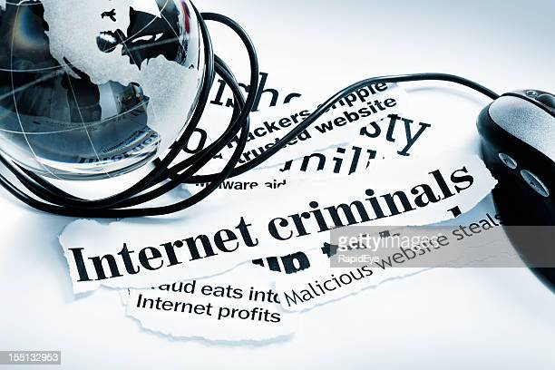 "Mouse, glass globe paperweight on ""Internet criminals"" headlines"