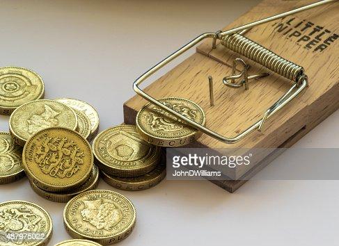 Mouse Trap Catches British Pound Coin Stock Photo Thinkstock