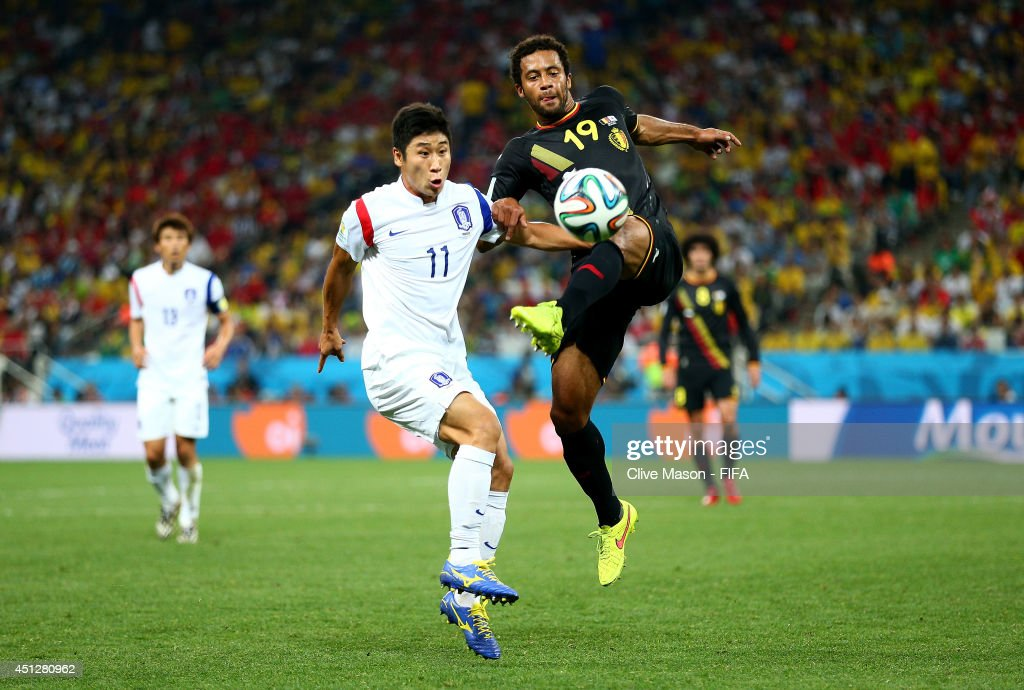 Moussa Dembele of Belgium and <a gi-track='captionPersonalityLinkClicked' href=/galleries/search?phrase=Lee+Keun-Ho&family=editorial&specificpeople=4435767 ng-click='$event.stopPropagation()'>Lee Keun-Ho</a> of South Korea compete for the ball during the 2014 FIFA World Cup Brazil Group H match between Korea Republic and Belgium at Arena de Sao Paulo on June 26, 2014 in Sao Paulo, Brazil.