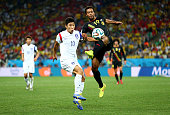 Moussa Dembele of Belgium and Lee KeunHo of South Korea compete for the ball during the 2014 FIFA World Cup Brazil Group H match between Korea...