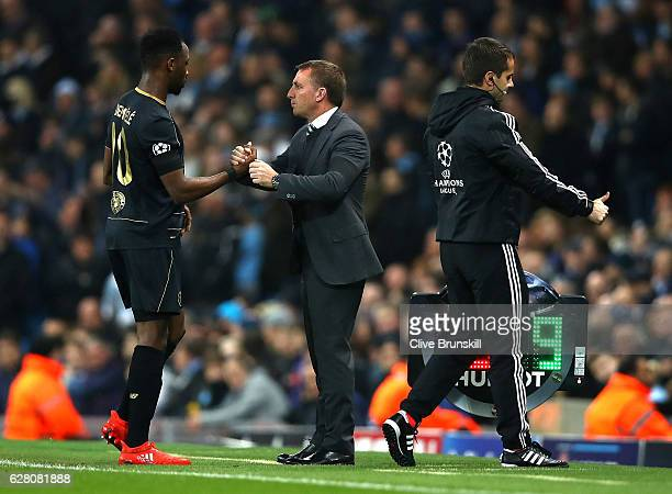 Moussa Dembele of Celtic and Brendan Rodgers manager of Celtic embrace after he is subbed during the UEFA Champions League Group C match between...