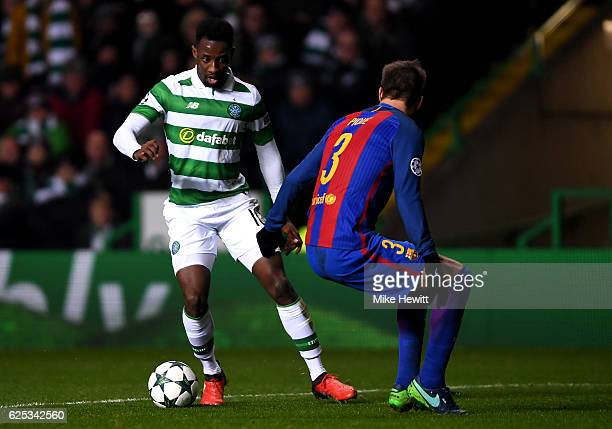 Moussa Dembele of Celtic attempts to take the ball past Gerard Pique of Barcelona during the UEFA Champions League Group C match between Celtic FC...