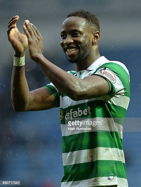 Moussa Dembele of Celtic celebrate at the final Whistle during the Scottish Premiership match between Rangers FC and Celtic FC at Ibrox Stadium on...