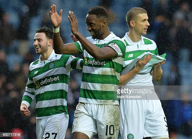 Moussa Dembele of Celtic celebrate at the final Whistle with teams mate Patrick Roberts and Jozo Simunovic during the Scottish Premiership match...