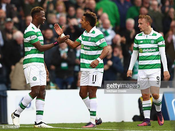 Moussa Dembele of Celtic celebrates scoring his sides first goal with team mates Scott Sinclair and Leigh Griffiths during the Betfred Cup Semi Final...