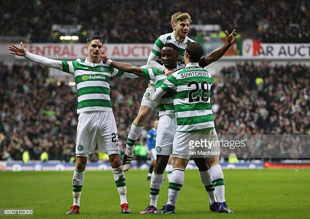 Moussa Dembele of Celtic celebrates scoring his team's first goal with his team mates during the Ladbrokes Scottish Premiership match between Rangers...