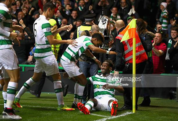 Moussa Dembele of Celtic celebrates with teammates after scoring his team's third goal during the UEFA Champions League group C match between Celtic...