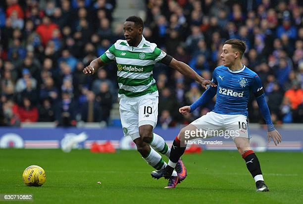 Moussa Dembele of Celtic controls the ball under pressure of Barrie McKay of Rangers during the Ladbrokes Scottish Premiership match between Rangers...