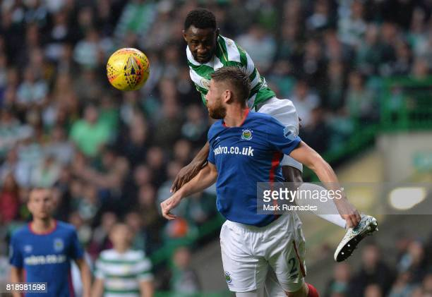 Moussa Dembele of Celtic is challenged by Mark Stafford of Linfield during the UEFA Champions League Qualifying Second Round Second Leg match between...