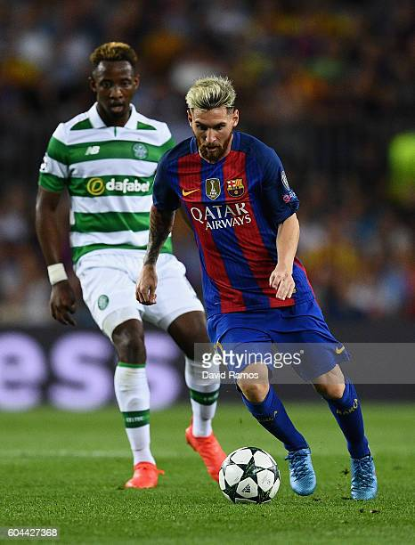 Moussa Dembele of Celtic looks on at Lionel Messi of Barcelona in action during the UEFA Champions League Group C match between FC Barcelona and...