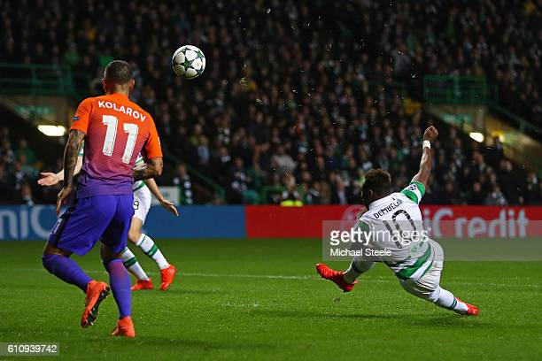 Moussa Dembele of Celtic scores his team's third goal during the UEFA Champions League group C match between Celtic FC and Manchester City FC at...