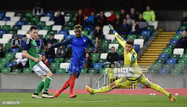 Moussa Dembele of France scores past Conor Mitchell of Northern Ireland during the UEFA European 2017 U21 qualifier between Northern Ireland and...