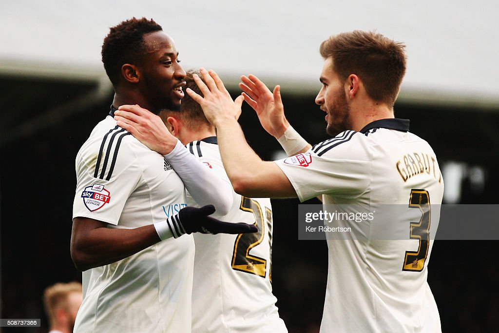 Moussa Dembele (L) of Fulham celebrates with team mate Luke Garbutt (R) after Markus Olsson of Derby County concedes an own goal during the Sky Bet Championship match between Fulham and Derby County at Craven Cottage on February 6, 2016 in London, England.