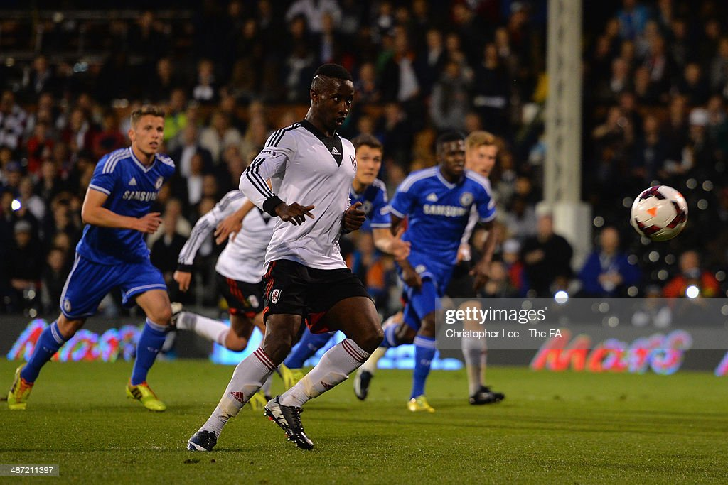 Moussa Dembele of Fulham chips the ball in the air as he takes a penalty and misses during the FA Youth Cup Final First Leg match between Fulham U18 and Chelsea U18 at Craven Cottage on April 28, 2014 in London, England.