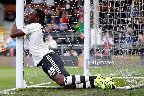 Moussa Dembele of Fulham clings to the goal net during the Sky Bet Football League Championship match between Fulham and Blackburn Rovers at Craven...