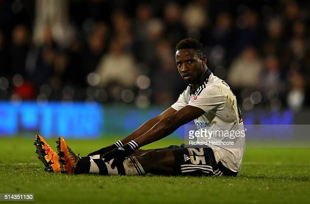 Moussa Dembele of Fulham sits dejected on the pitch during the Sky Bet Championship match between Fulham and Burnley at Craven Cottage on March 8...