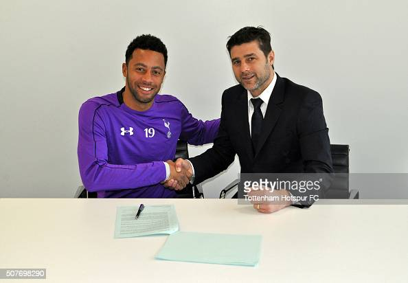 Moussa Dembele of Tottenham Hotspur poses with Head Coach Mauricio Pochettino after signing a new contract which will run until 2019 at the Tottenham...