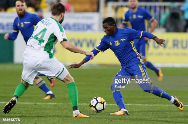 Moussa Doumbia of FC Rostov RostovonDon is challenged by Vladimir Granat of FC Rubin Kazan during the Russian Premier League match between FC Rostov...