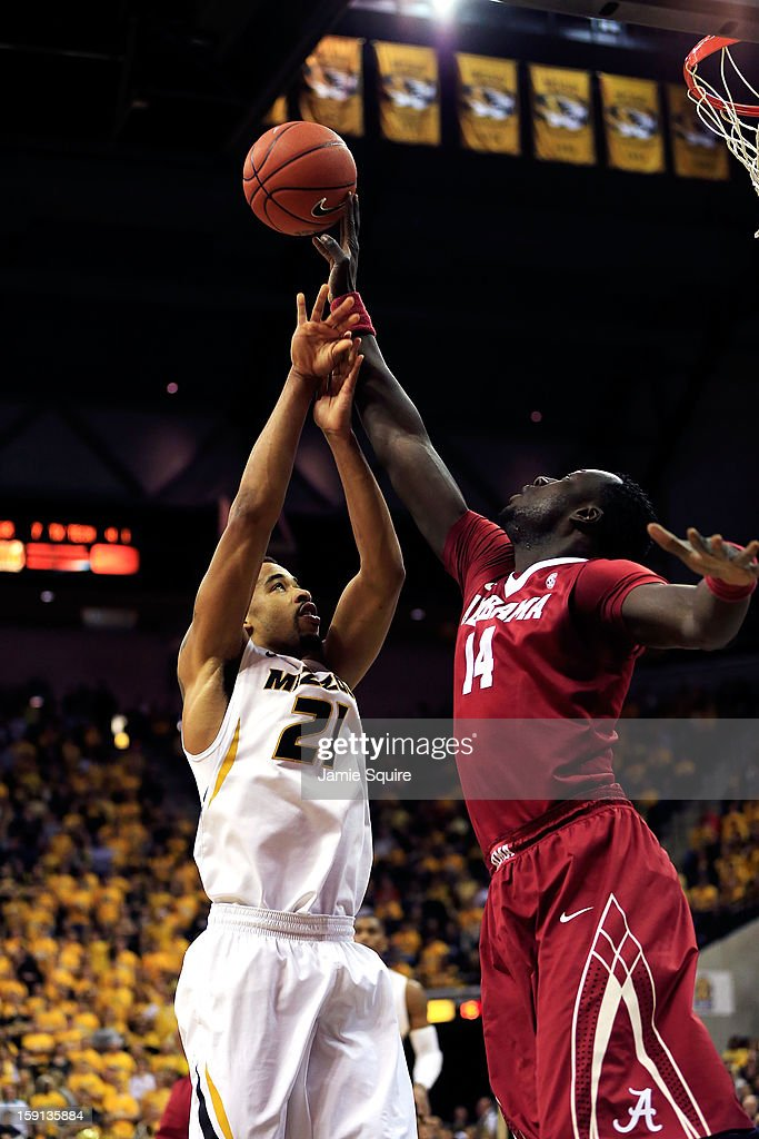 Moussa Gueye #14 of the Alabama Crimson Tide blocks a shot by Laurence Bowers #21 of the Missouri Tigers during the game at Mizzou Arena on January 8, 2013 in Columbia, Missouri.