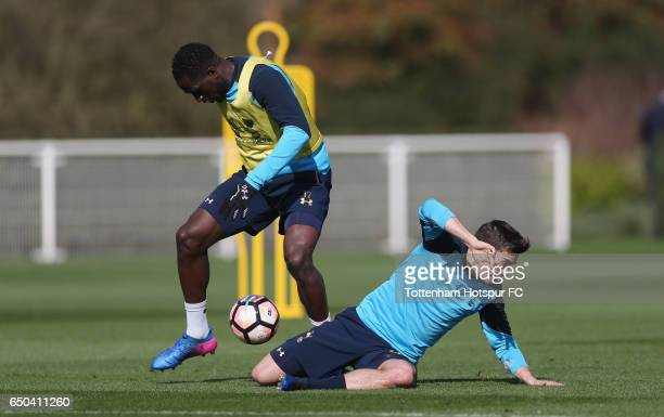 Moussa Sissoko and Harry Winks of Tottenham during the Tottenham Hotspur training session at Tottenham Hotspur Training Centre on March 9 2017 in...
