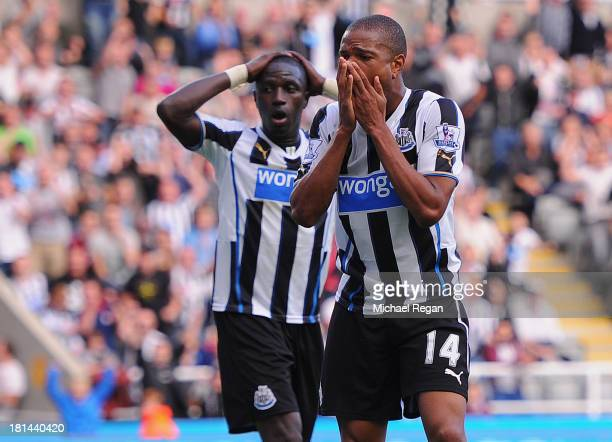 Moussa Sissoko and Loic Remy of Newcastle look dejected during the Barclays Premier League match between Newcastle United and Hull City at St James'...
