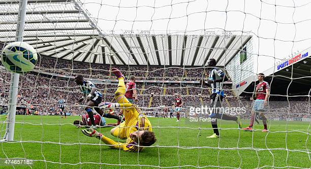 Moussa Sissoko heads the opening goal for Newcastle past Adrian of West Ham during the Barclays Premier League match between Newcastle United and...