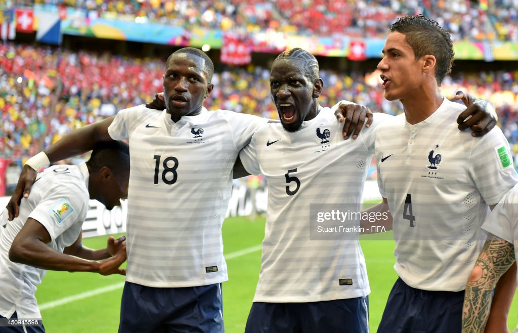 <a gi-track='captionPersonalityLinkClicked' href=/galleries/search?phrase=Moussa+Sissoko&family=editorial&specificpeople=4191251 ng-click='$event.stopPropagation()'>Moussa Sissoko</a>, <a gi-track='captionPersonalityLinkClicked' href=/galleries/search?phrase=Mamadou+Sakho&family=editorial&specificpeople=4154099 ng-click='$event.stopPropagation()'>Mamadou Sakho</a> and Raphael Varane of France celebrate their team's second goal by Blaise Matuidi (not pictured) during the 2014 FIFA World Cup Brazil Group E match between Switzerland and France at Arena Fonte Nova on June 20, 2014 in Salvador, Brazil.
