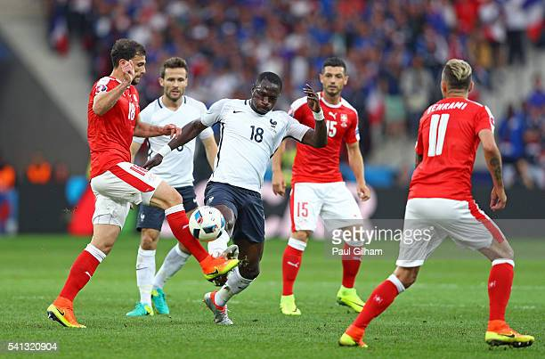 Moussa Sissoko of France and Admir Mehmedi of Switzerland compete for the ball during the UEFA EURO 2016 Group A match between Switzerland and France...