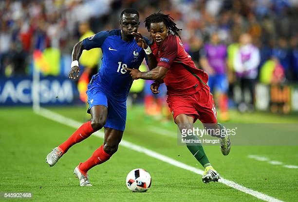 Moussa Sissoko of France and Renato Sanches of Portugal compete for the ball during the UEFA EURO 2016 Final match between Portugal and France at...