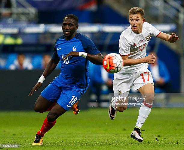 Moussa Sissoko of France battles for the ball with Oleg Shatov of Russia during the International Friendly match between France and Russia held at...