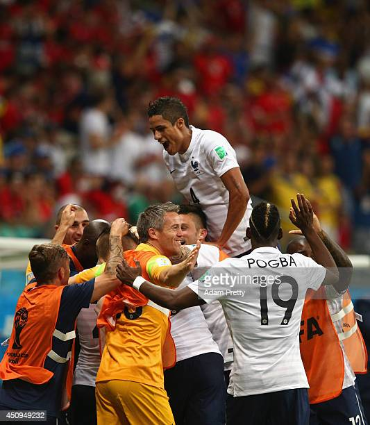 Moussa Sissoko of France celebrates scoring his team's fifth goal with teammates during the 2014 FIFA World Cup Brazil Group E match between...