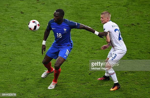 Moussa Sissoko of France controls the ball under pressure of Ari Skulason of Iceland during the UEFA EURO 2016 quarter final match between France and...